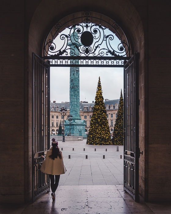 Christmas in Paris Place Vendôme's Christmas trees framed by door by Dancing the Earth