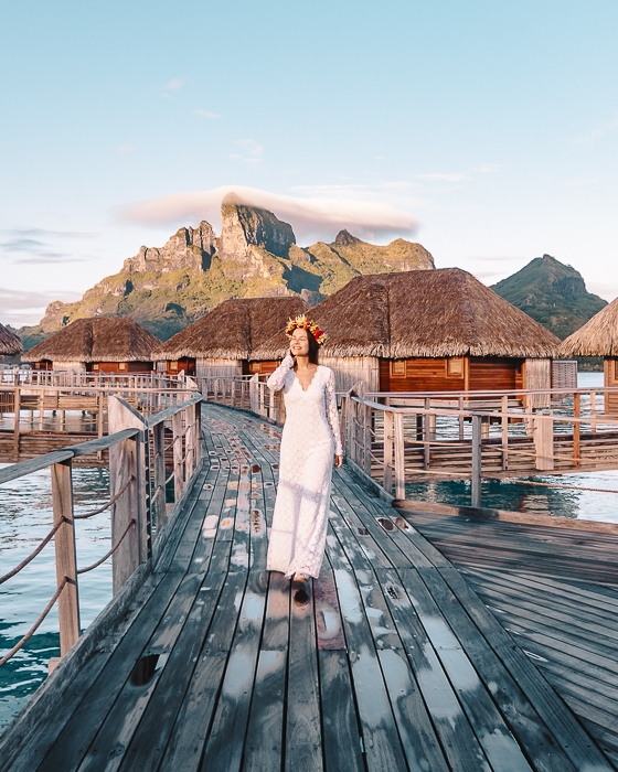 Four Seasons Bora Bora walking at sunrise with Mount Otemanu behind by Dancing the earth