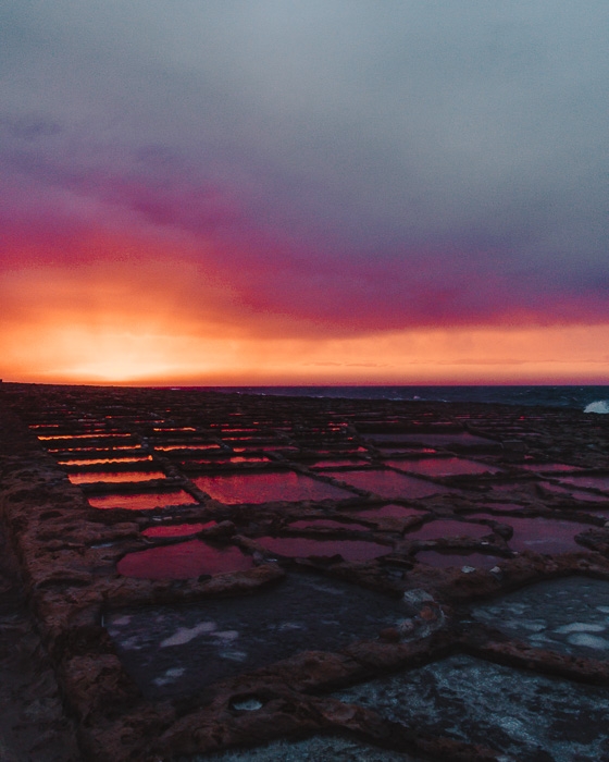 Malta travel guide Gozo island Ghajn Barrani salt pans right after sunset by Dancing the Earth