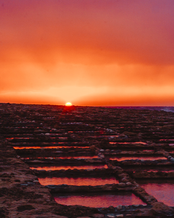 Malta travel guide Gozo island Ghajn Barrani salt pans at sunset by Dancing the Earth