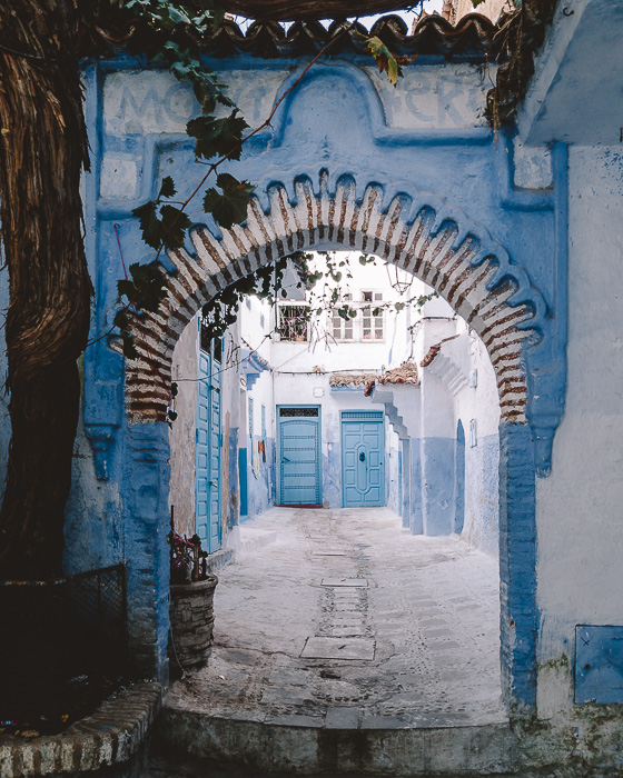 Morocco travel guide Chefchaouen arch by Dancing the Earth