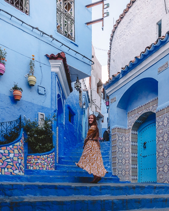 Morocco travel guide Chefchaouen blue stairs and tiled walls by Dancing the Earth