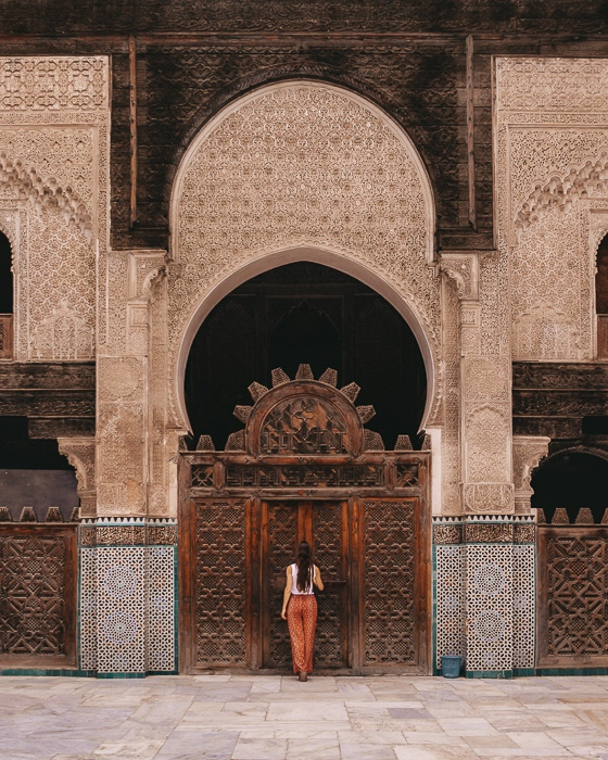 Morocco travel guide Fes Bou Inania Medersa main door by Dancing the Earth