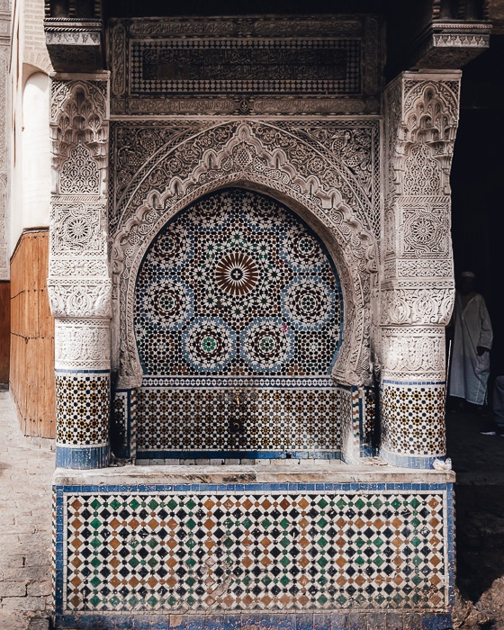 Morocco travel guide Fez tiled fountain by Dancing the Earth