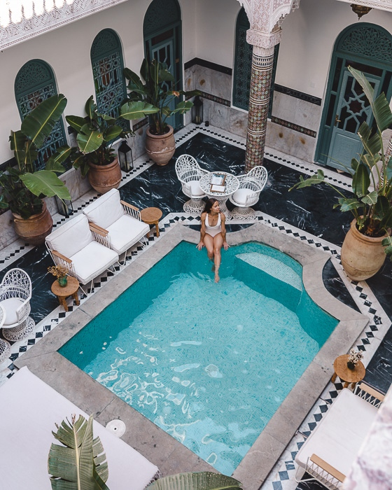 Chilling by the pool of riad Ksar Kasbah in Marrakesh by Dancing the Earth