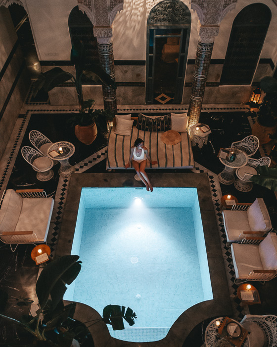 Morocco travel guide Marrakesh Ksar Kasbah riad pool by night from upstairs by Dancing the Earth