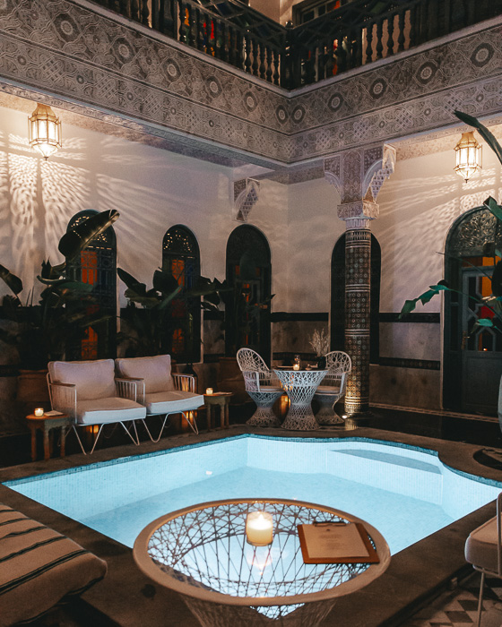 Morocco travel guide Marrakesh Ksar Kasbah riad pool by night by Dancing the Earth