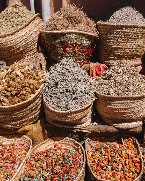 Spices stall in Marrakesh by Dancing the Earth