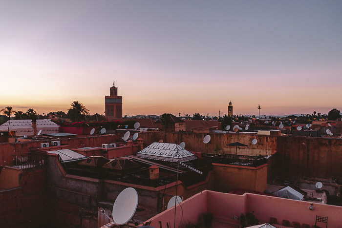 Morocco travel guide sun setting over Marrakesh from riad Ksar Kasbah by Dancing the Earth