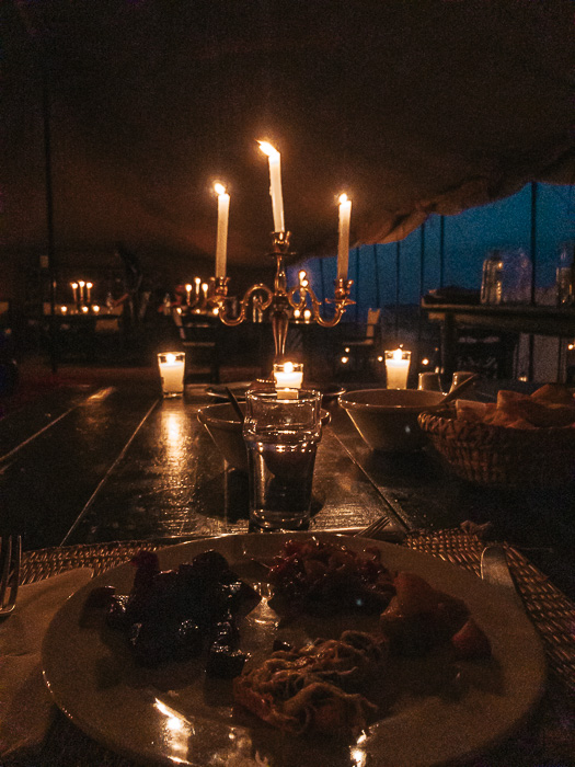 Morocco travel guide Scarabeo Camp candlelit dinner by Dancing the Earth