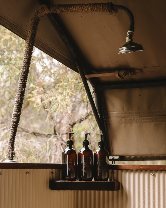 Paperbark Camp deluxe tent shower by Dancing the Earth