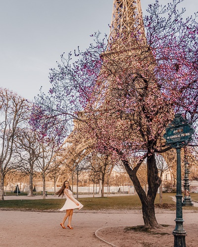 Spring in Paris twirling under a plum tree and Eiffel Tower by Dancing the Earth