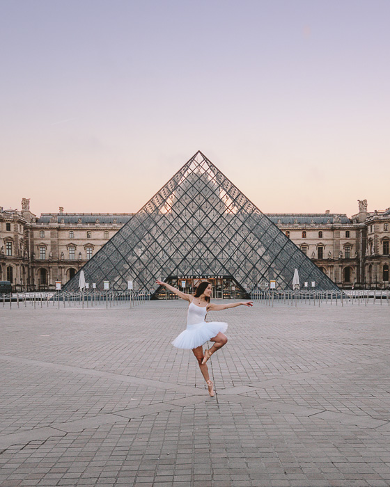 Dancing in front of the Louvre pyramid by Dancing the Earth