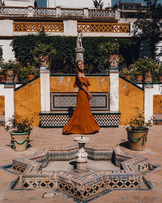Seville Casa de Pilatos yellow wall by Dancing the Earth