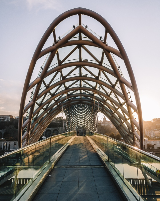 Tbilisi Peace Bridge at sunrise by Dancing the Earth