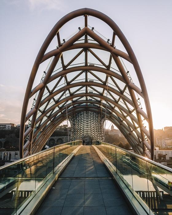 Tbilisi Peace Bridge at sunrise by Dancing the Earth