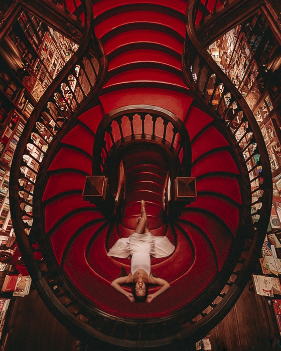 Livraria Lello staircases from upstairs by Dancing the Earth