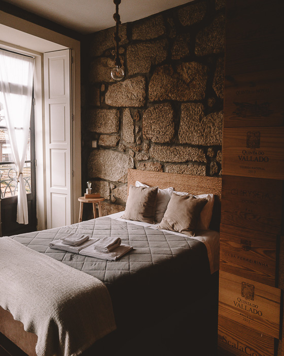 Porto weekend itinerary Bedroom at Belos Aires apartment by Dancing the Earth