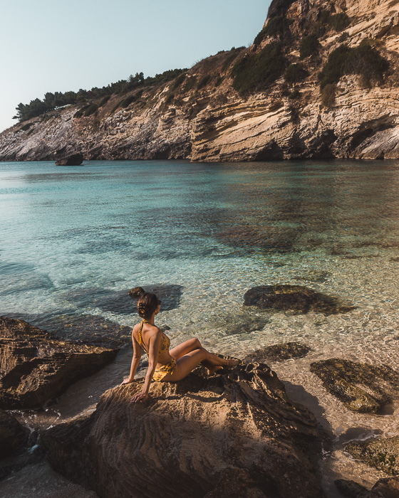 Sunbathing in Porto Miggiano, Puglia travel guide by Dancing the Earth