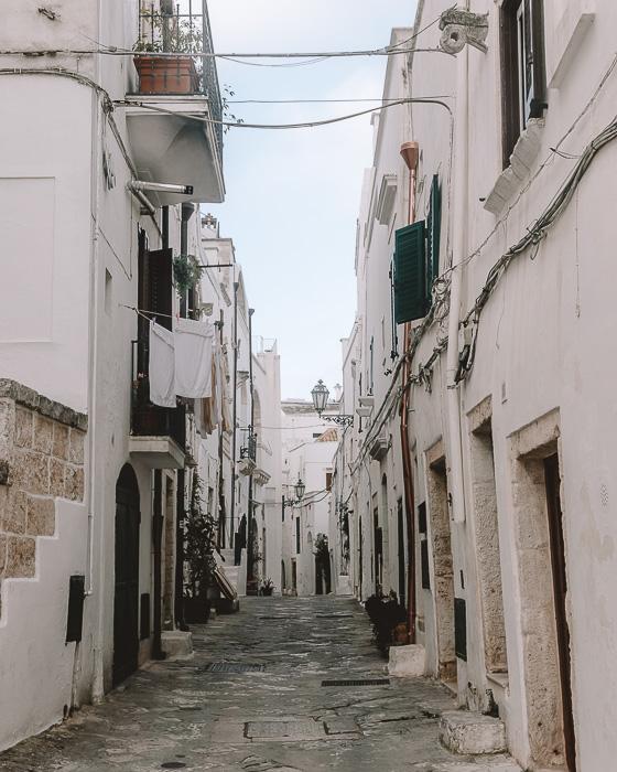 Coblestone white street in Ostuni, Puglia travel guide by Dancing the Earth