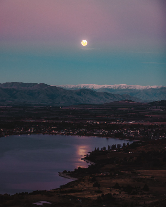 Pink sky and moon over Wanaka, Dancing the Earth
