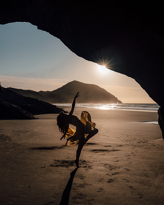 Dancing inside a cave in Wharariki Beach, South Island, Dancing the Earth