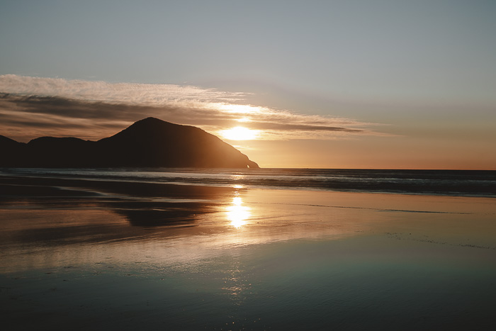 Sunset reflection in Wharariki Beach, Dancing the Earth